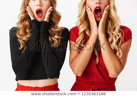 cropped image of two shocked young smartly dressed women stock photo © deandrobot