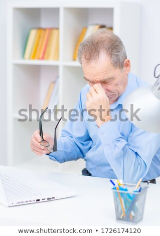 Portrait of a smiling senior businessman sitting in his office stock photo © Minervastock