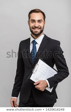 бизнесмен · открытых · ноутбук · костюм · бумаги - Сток-фото © ra2studio