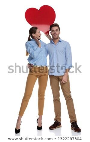miłości · para · trzymając · się · za · ręce · stałego · szary · studio - zdjęcia stock © feedough