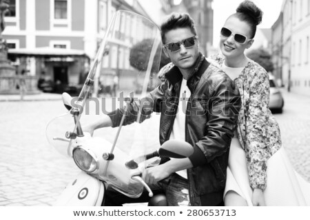 Portrait of romantic couple man and woman, riding on motorbike t Stock photo © deandrobot