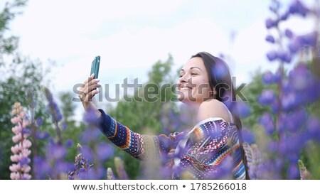 Dansen meisje bloemen jong meisje zon hemel Stockfoto © liolle