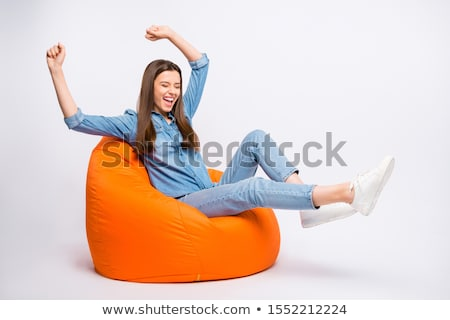 photo of happy young woman with beautiful long hair screaming an stock photo © deandrobot
