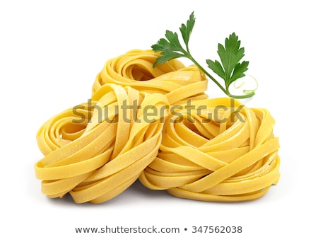 Raw Tagliatelle Pasta Nests Isolated On White Background Stock photo © Bozena_Fulawka