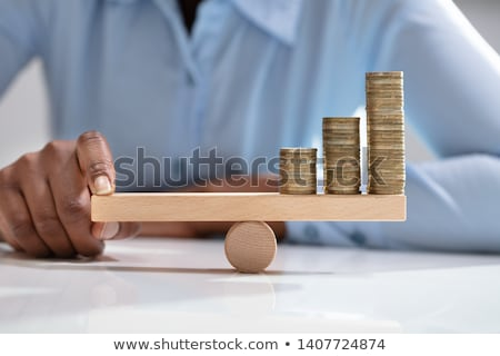 Businesswoman Balancing Stacked Coins With Finger Stock photo © AndreyPopov