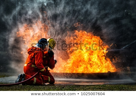 Homens fogo bombeiros água trabalhar Foto stock © Kzenon
