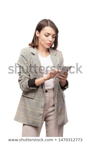 Young serious mobile woman in formalwear scrolling in gadget Stock photo © pressmaster
