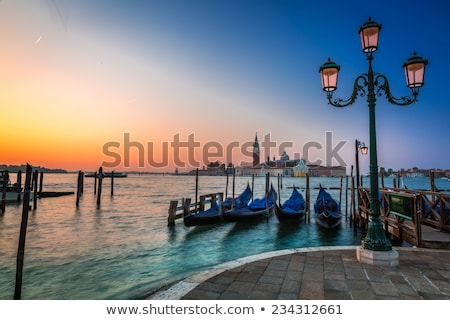 Traditional gondolas floating on the canal in Venice, in front o Stock photo © boggy