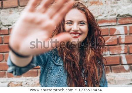 Téglafal nő visel fejhallgató hát lány Stock fotó © Lopolo