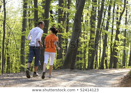 Couple jogging in beech forest Stock photo © lichtmeister