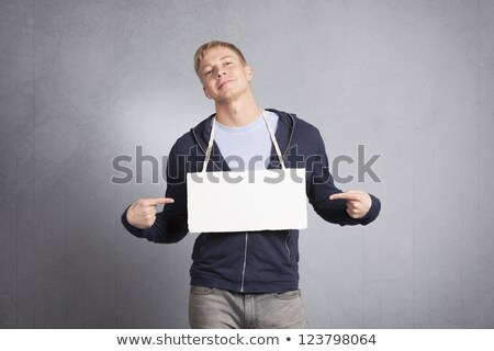 Haughty man pointing fingers at empty signboard. Stock photo © lichtmeister