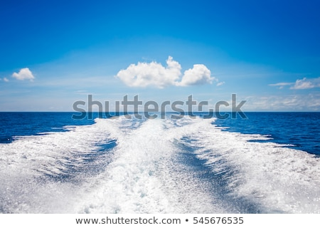Stock photo: Wake from boat on water surface