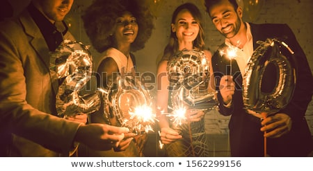 Group of party people celebrating the arrival of 2020 Stock photo © Kzenon