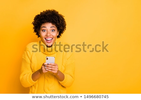 Happy young stylish female in casual pullover holding black box by her chest Stock photo © pressmaster