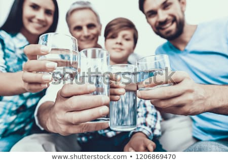 senior woman in glasses with glass of water Stock photo © dolgachov