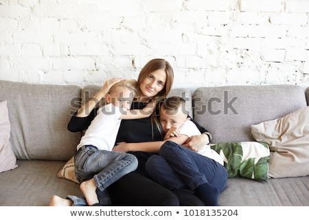 Belo mãe dois sofá família menina Foto stock © ruslanshramko