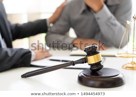 lawyer having meeting and consoling solution to his clients prov Stock photo © snowing