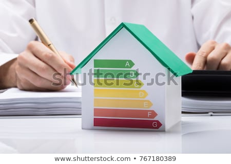 Man Calculating House Energy Efficiency Rate Stock photo © AndreyPopov