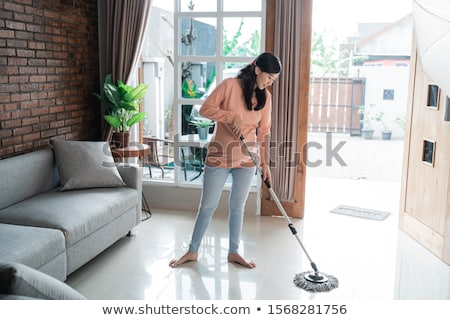 happy asian woman with mop cleaning floor at home Stock photo © dolgachov