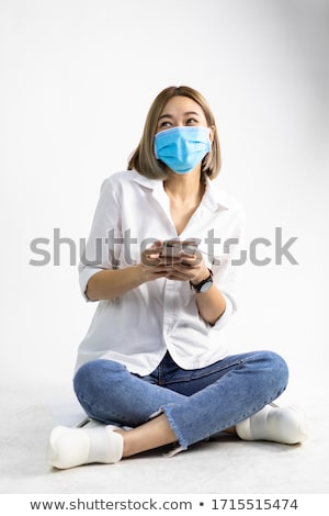 Doctor wearing protection face mask against coronavirus. Medical staff preventive PPE Stock photo © Maridav
