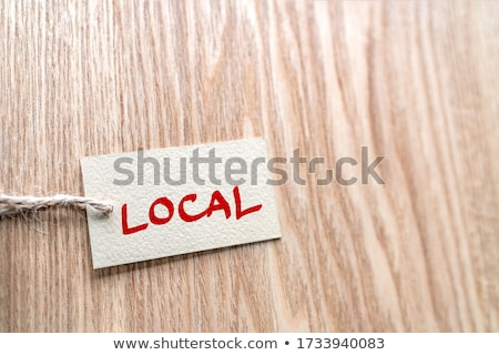 LOCAL handwritten paper gift box label on brown wood texture background , for buying locally small e Stock photo © Maridav