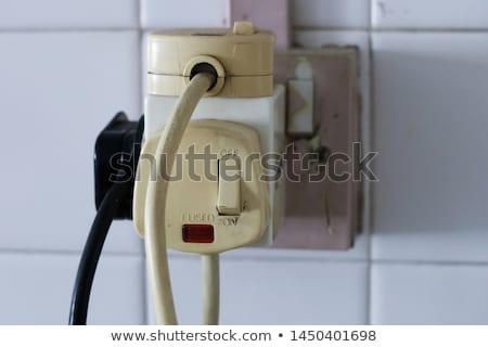 The old socket with three plugs stock photo © vlaru