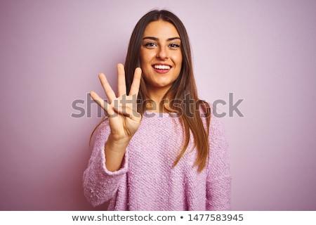 Femme main nombre quatre Palm Photo stock © Rebirth3d