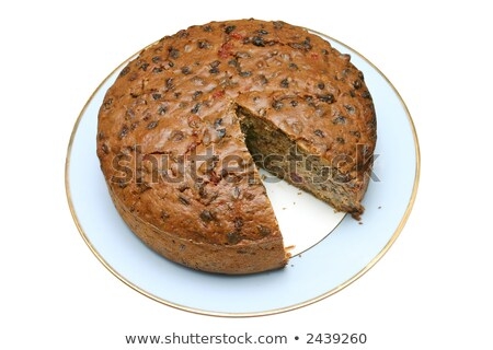 Home made fruit cake with a slice missing. Stock photo © latent
