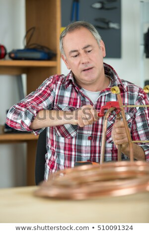 Artisan sawing tube Stock photo © photography33