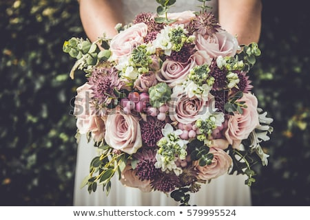 portrait of young bride with flower bouquet stock photo © massonforstock