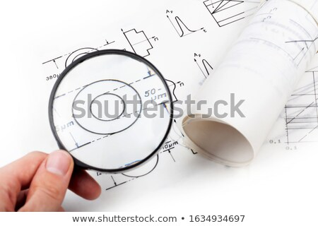 engineer examining a technical drawing stock photo © photography33