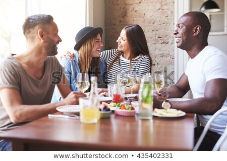 Woman watching a couple eating in a restaurant Stock photo © photography33