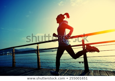 Woman runs out of the sea stock photo © Anna_Om