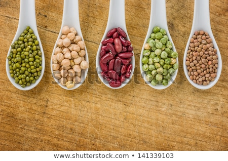 Various Legumes On Porcelain Spoons Photo stock © Zerbor
