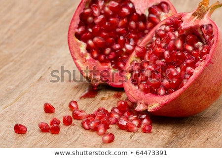 cut open pomegranate on wooden cutting board stock photo © avdveen
