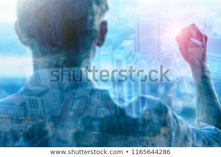 Gülen işadamı yazı beyaz tahta genç çekici Stok fotoğraf © jeliva