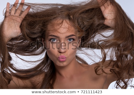 Portrait of a young beautiful girl with bright makeup in blue wi Stock photo © vlad_star