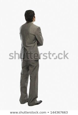 üzletember · vezető · hátsó · nézet · fiatal · zene · kéz - stock fotó © stockyimages