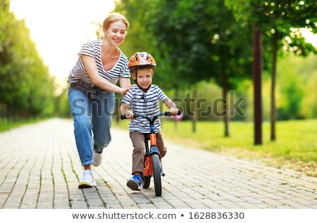 boy on bike with mother stock photo © monkey_business