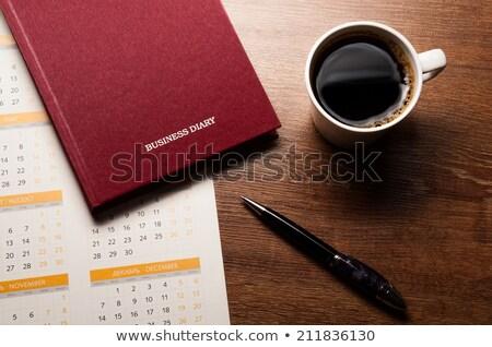 diary with large pen on the oak desk Stock photo © mizar_21984