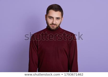 man wearing burgundy sweater looking at the camera stock photo © feedough