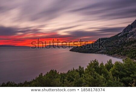 spectacular sunset at the beach seen from ocean Stock photo © meinzahn