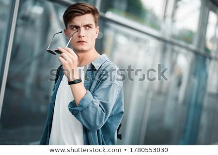 młody · człowiek · okulary · uśmiechnięty · kamery · twarz · lata - zdjęcia stock © feedough