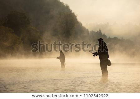 fishing on river in fog stock photo © mikko