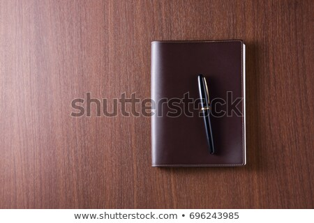 brown notebook with pen stock photo © scenery1