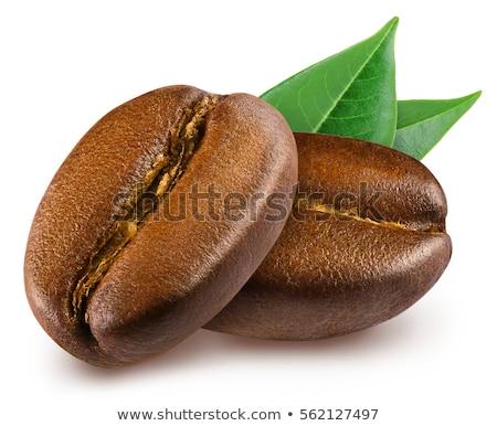 Macro tiro grãos de café isolado preto Foto stock © dla4