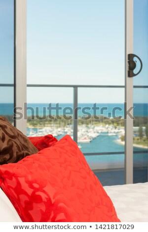Pormenor almofadas varanda vermelho marrom cama Foto stock © jrstock