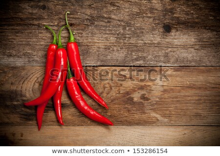 hot chili peppers on old wooden table with place for text Stock photo © Valeriy