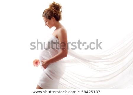 grávida · menina · em · pé · flores · feliz - foto stock © svetography