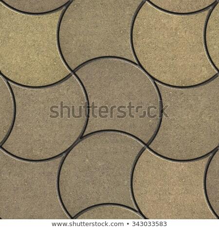 decorative wavy pavement slabs in beige tones stock photo © tashatuvango